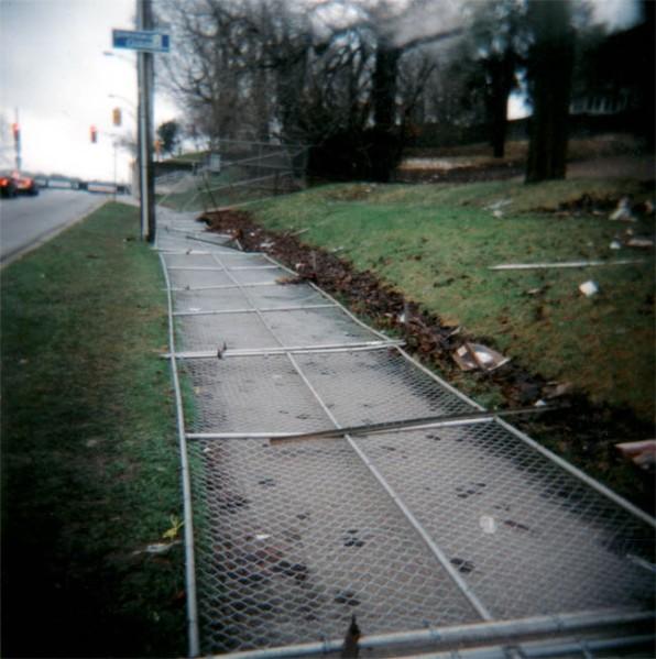 fence on sidewalk urban